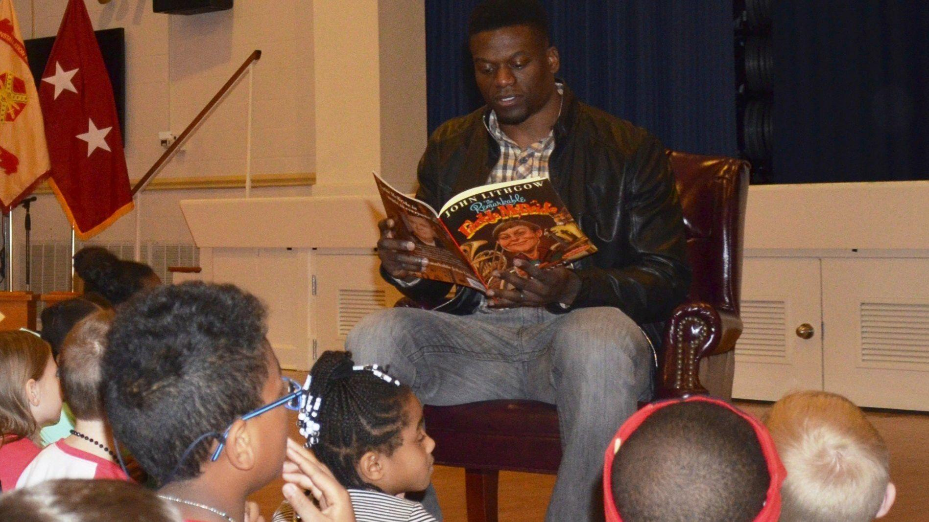 Benjamin Watson reading to children
