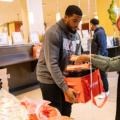 Bobby Wagner packing up thanksgiving meals